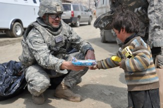 Soldier interacting with refugee child in Afghanistan