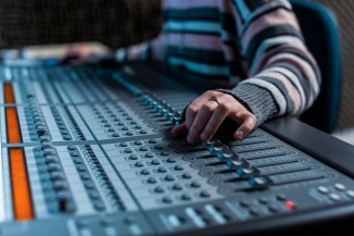 mixing board with hands